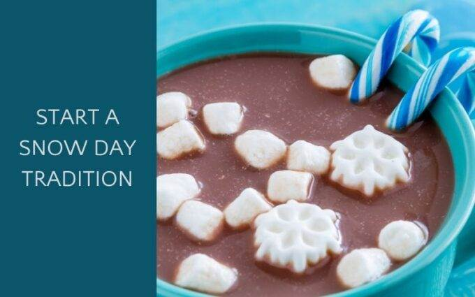 hot chocolate in blue mug with snowflake marshmallows