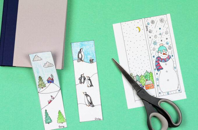 winter bookmark coloring page cut in half with scissors and book