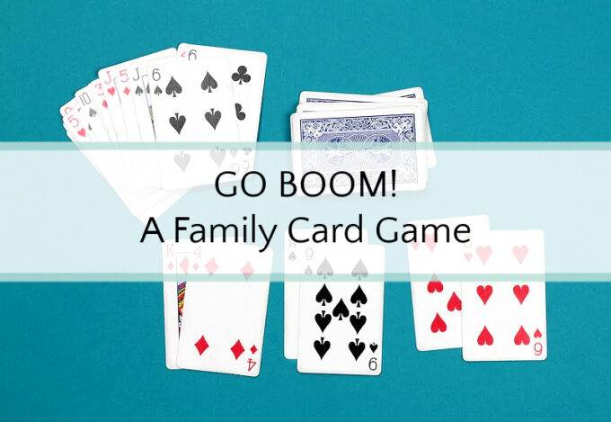 Playing cards face up in four stacks, on stack face down on blue background with Go Boom A Family Card Game overlayed