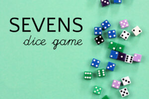Colored dice spread across an aqua colored background for sevens dice game