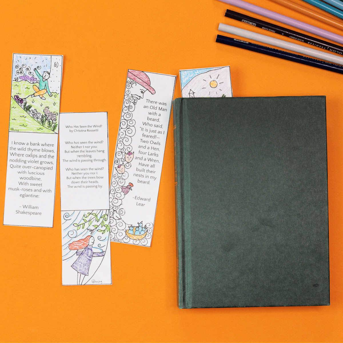 four paper poetry bookmarks with book and colored pencils
