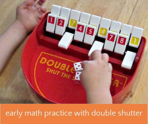 child playing double shutter math game