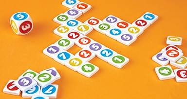 colorful sumoku game tiles in criss cross pattern on orange background