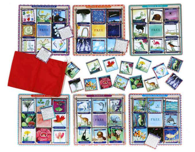 four colorful bingo boards and cards with red bag