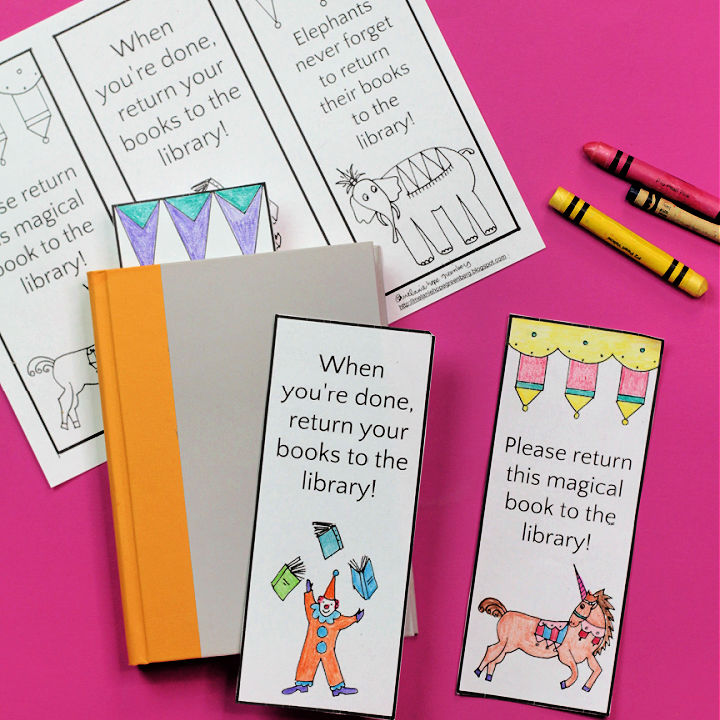 Paper library bookmarks with book and crayons