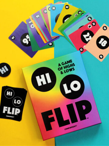 Hi Lo Flip game box and cards on blue and yellow background