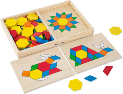 Colorful children's math toy pattern blocks in open box with animal and star design layouts